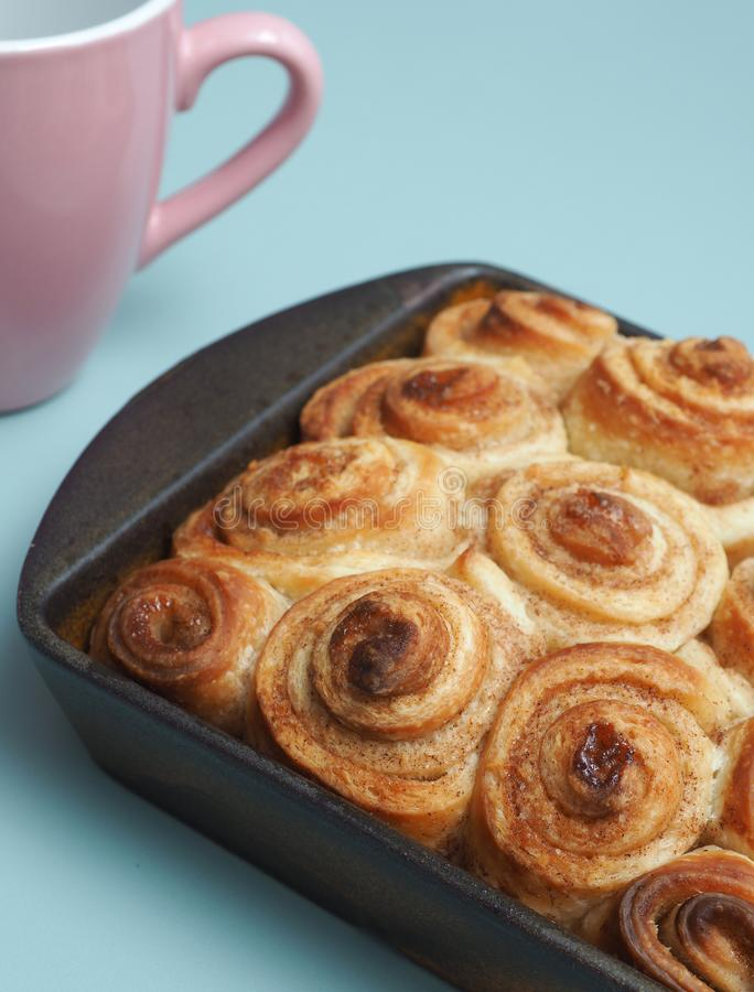 Tasty cinnamon pastry. Sweet and tasty cinnamon pastry in a ceramic baking dish stock photo