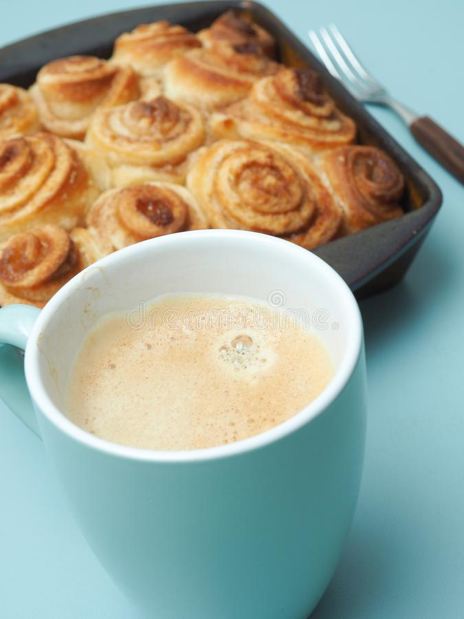 Tasty cinnamon pastry. Sweet and tasty cinnamon pastry in a ceramic baking dish royalty free stock photos
