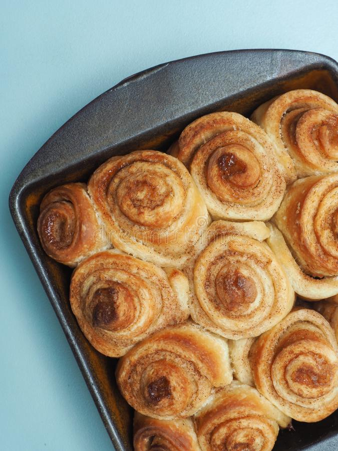 Tasty cinnamon pastry. Sweet and tasty cinnamon pastry in a ceramic baking dish royalty free stock image