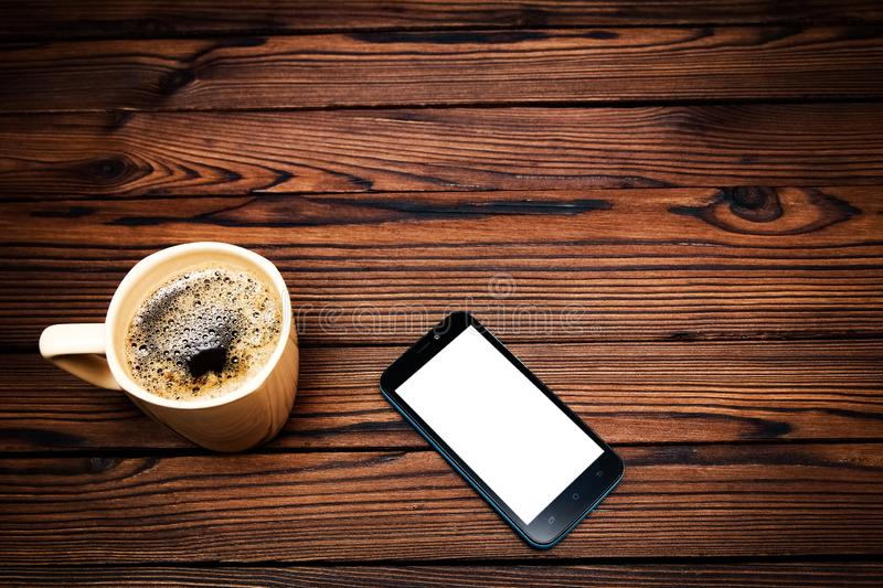 Tasty coffee with phone on background. A tasty coffee with phone on background stock photo