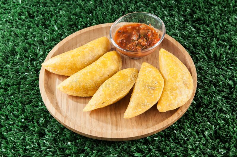 Tasty colombian food, fried empanada; photo on wooden background stock photography