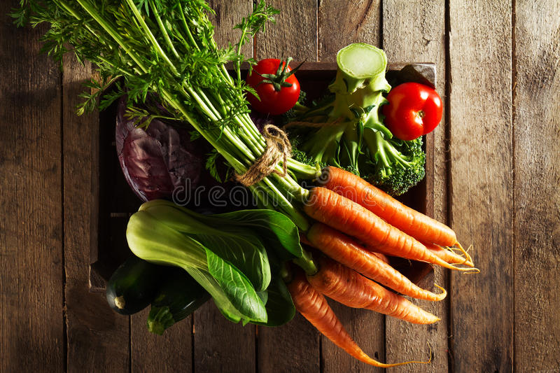 Tasty colorful fresh various seasonal vegetables in wooden box o royalty free stock photos