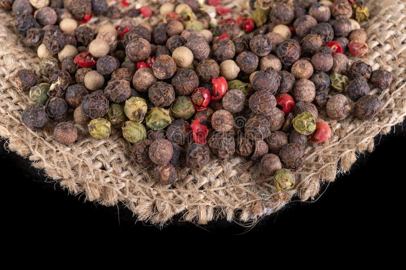 Tasty colorful pepper on jute material. Fresh spices used in home cooking stock photography