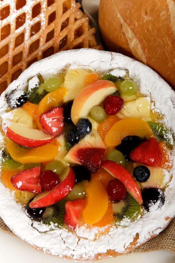 Tasty colorful tart. Close up of a tasty sweet colorful tart with fresh fruits and jelly. Fruits mix. Studio shot royalty free stock photography