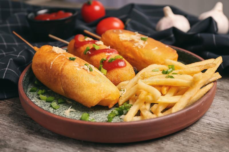 Tasty corn dogs with ketchup plate stock photo