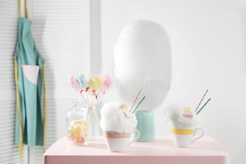Tasty cotton candy desserts and other treats on table stock photos
