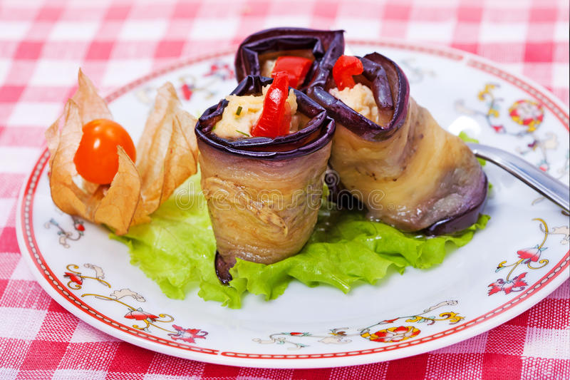 Tasty course - rolls of aubergine royalty free stock photography