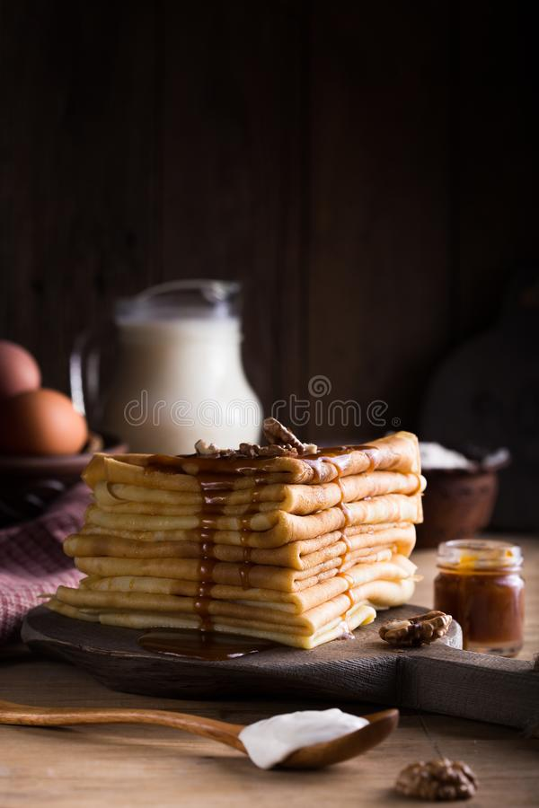 Tasty crepes with Raspberry jam. French crepes, russian or ukrainian blini or blintzes with fresh Raspberry on blue plate. Masleni royalty free stock image