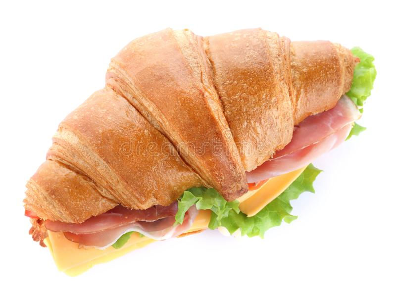 Tasty croissant sandwich with ham and cheese isolated on white stock photo