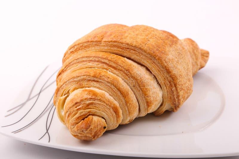 Croissant. Tasty croissant on white background royalty free stock photo