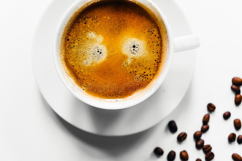 Tasty cup of coffee on white desk. royalty free stock photo