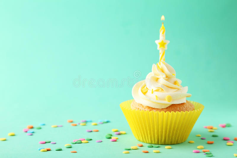 Tasty Cupcake With Candle On The Green Background Stock