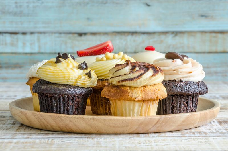 Tasty cupcake on wooden table on vintage background stock photo
