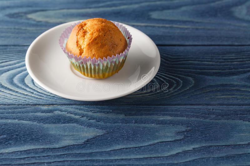 Tasty cupcakes on plate, on light background royalty free stock image