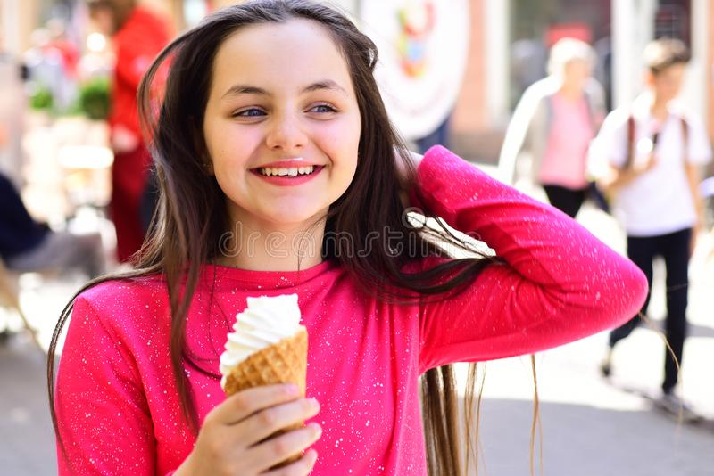 So tasty. Cute girl smiling with ice cream. Happy girl child eating ice cream in hot weather. Pretty girl hold ice cream. Cone on summer day. Enjoying frozen stock photo