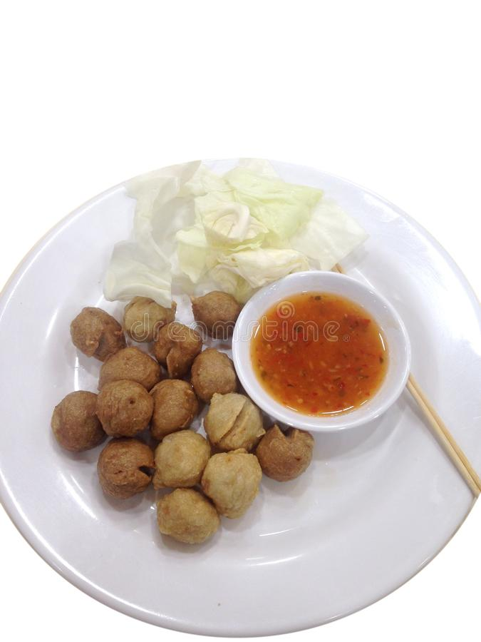 Tasty delicious grilled meat ball on white round dish. In a food canteen market in THAILAND with vegetable and dips, local food adapt from street food into city royalty free stock photography