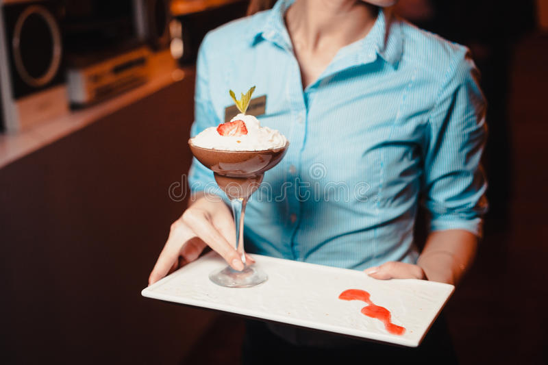Tasty dessert with strawberries and cream stock image