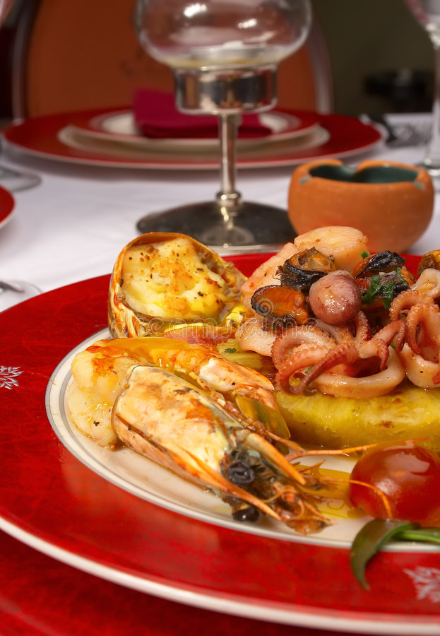 Tasty dish from sea products at restaurant royalty free stock photography