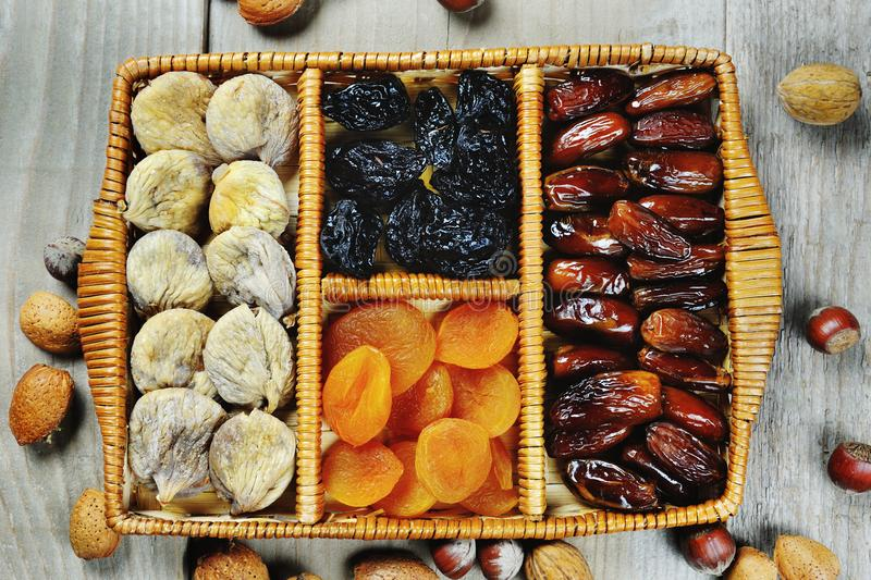 Dried fruits prunes dates apricots figs symbols of holiday Tu Bishvat. Tasty dried fruits prunes dates apricots figs symbols of judaic holiday Tu Bishvat royalty free stock photos
