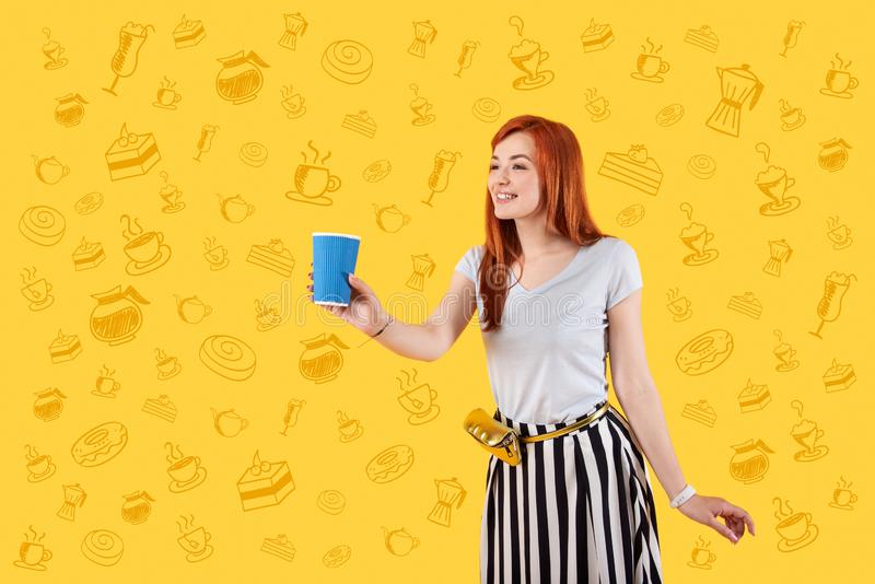 Friendly waitress smiling and offering a glass of coffee royalty free stock photo