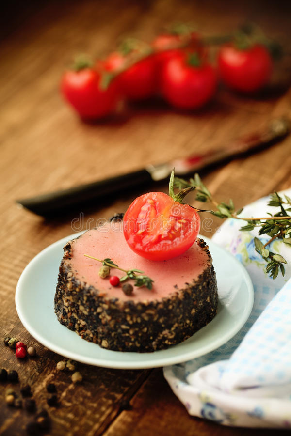 Tasty duck pate appetizer with fresh herbs stock photography