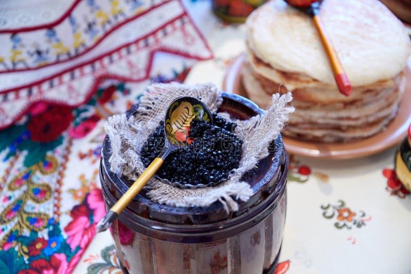Tasty fish caviar on pancakes lies stock image