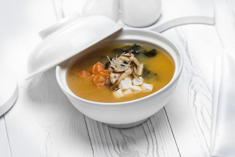 Tasty fish soup with onion in a bowl royalty free stock image