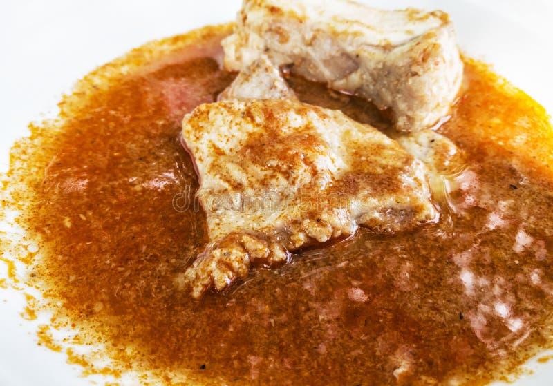 Tasty fish soup in white ceramic bowl, food scene stock photo