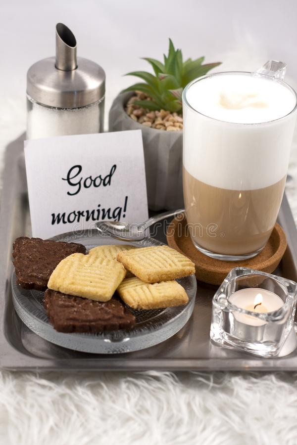 Tasty foamy coffee. In a glass royalty free stock photos