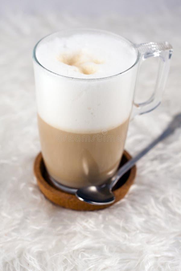 Tasty foamy coffee. In a glass royalty free stock image