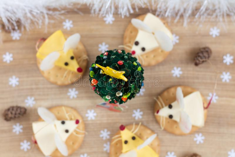 Tasty food for Chinese New Year of the white rat. Mice shaped cheese appetizer. Festive mood. Blurred background stock images