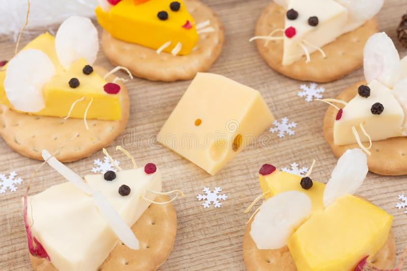 Tasty food for Chinese New Year of the white rat. Mice shaped cheese appetizer. Festive mood stock photo