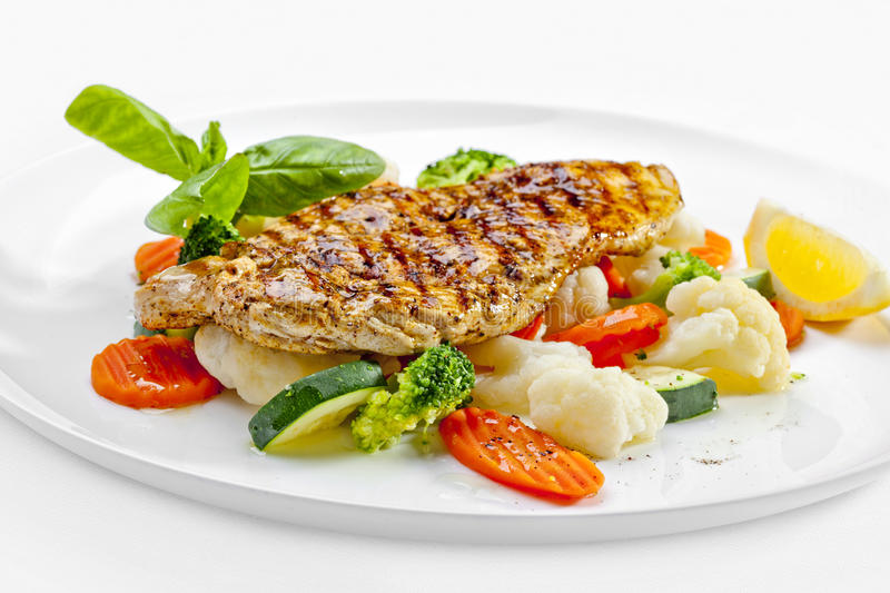 Tasty food. Grilled chicken breasts and vegetables . High quality image royalty free stock image