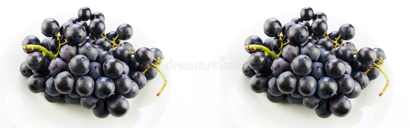 Tasty fresh black grape in a bowl stock photography