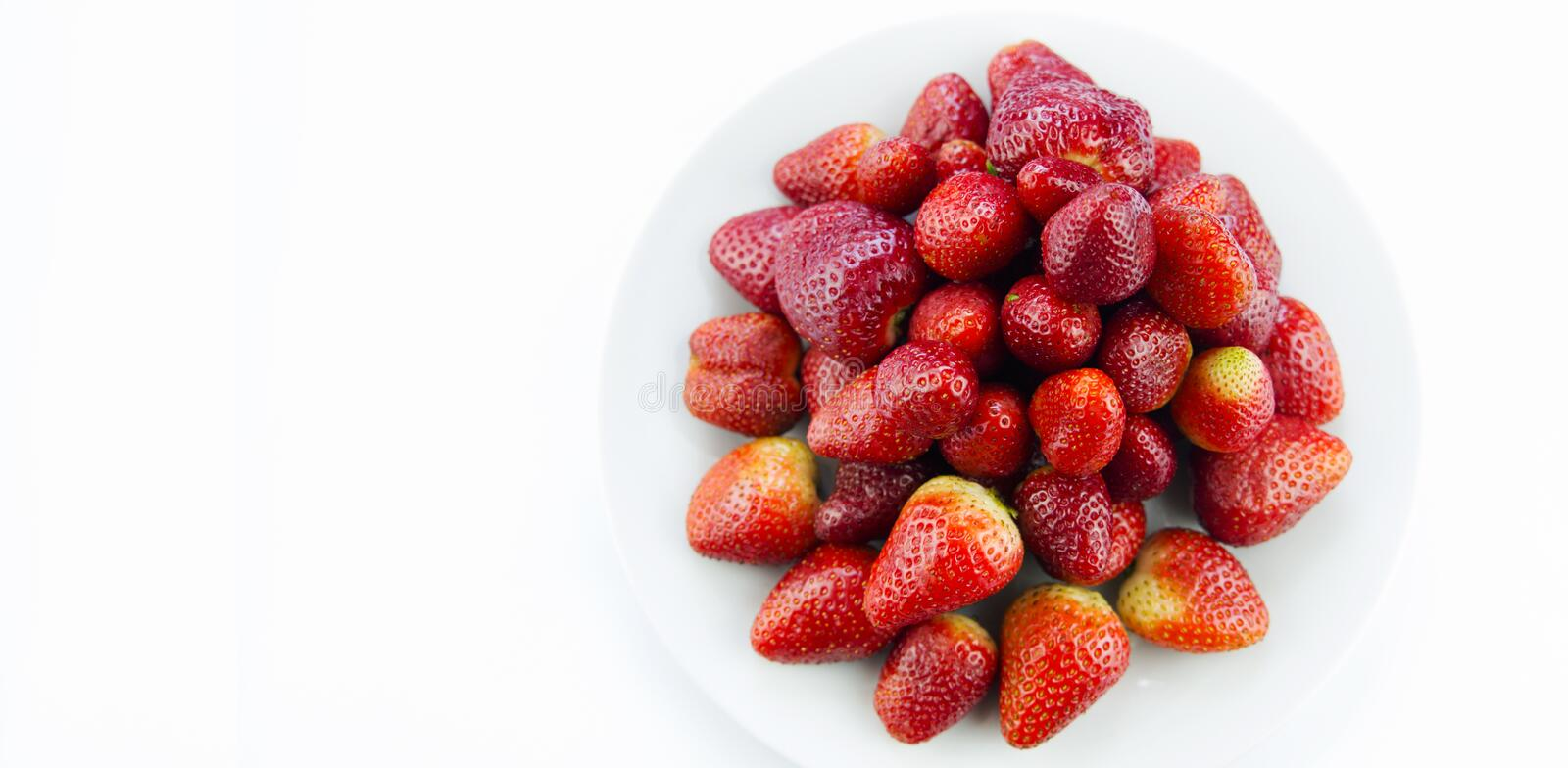 Tasty fresh red strawberry in a bowl stock image