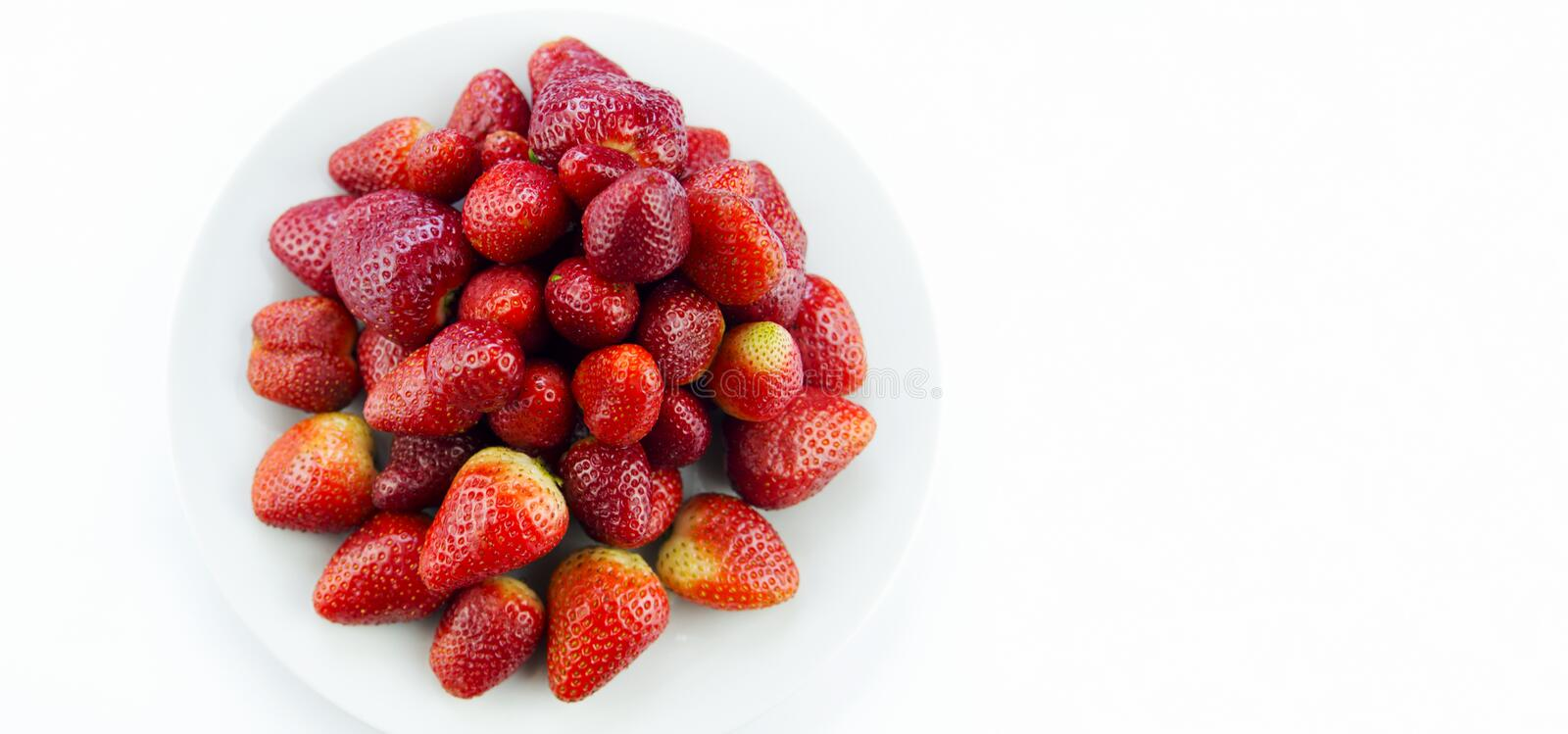 Tasty fresh red strawberry in a bowl royalty free stock photo