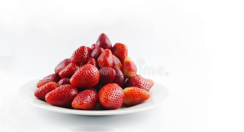 Tasty fresh red strawberry in a bowl royalty free stock photos
