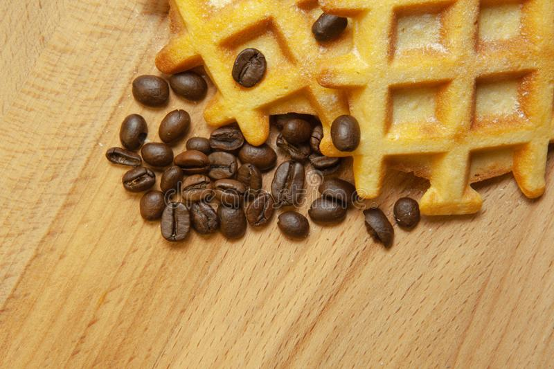 Tasty fresh Vienna wafers, grain coffee on a wooden background, copy space stock photos