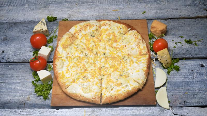 Tasty freshly baked pizza on wooden tray. Frame. Juicy appetizing pizza on wooden tray professionally-baked pizza ready stock image