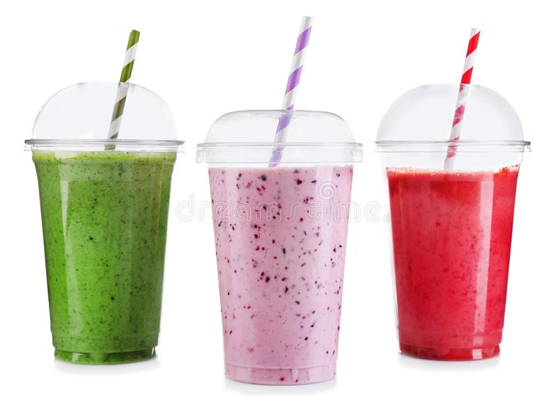 Tasty fruit cocktails in plastic cups isolated stock photos