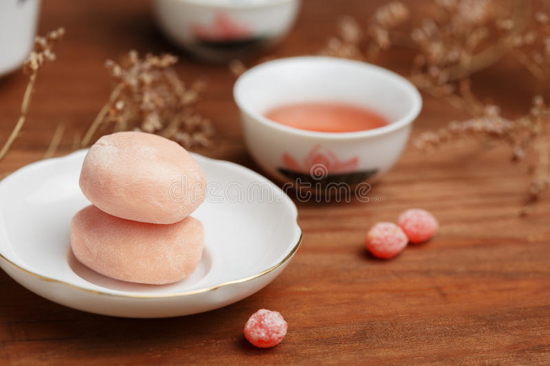 Tasty fruit mochi cakes in white porcelain saucer with chinese c royalty free stock photos