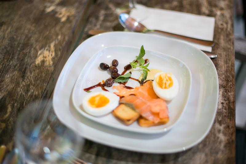 A light appetizing snack made from eggs on a wooden table royalty free stock photos
