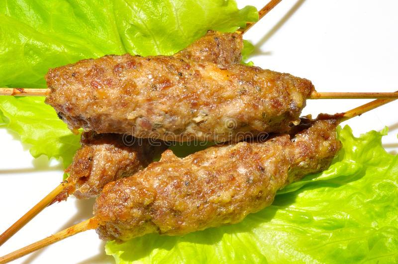 Tasty grill kebab with green salat latucce royalty free stock photo