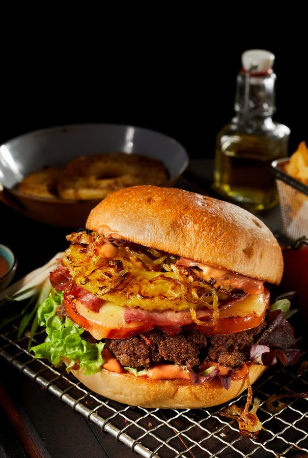 Tasty grilled Hawaiian burger with pineapple royalty free stock images