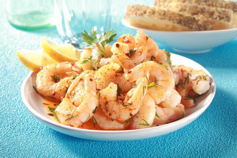 Tasty grilled shelled pink shrimps or prawns stock photography