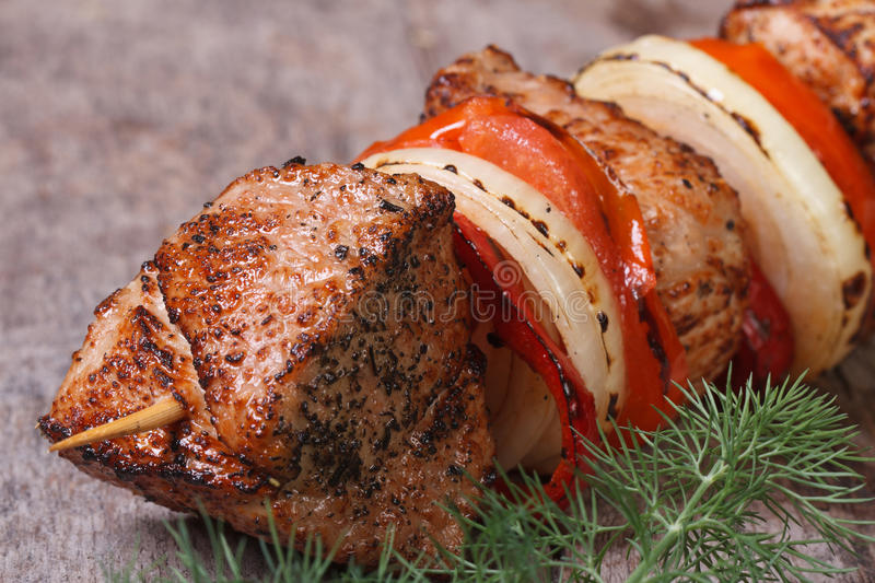 Tasty grilled shish kebab with vegetables royalty free stock images