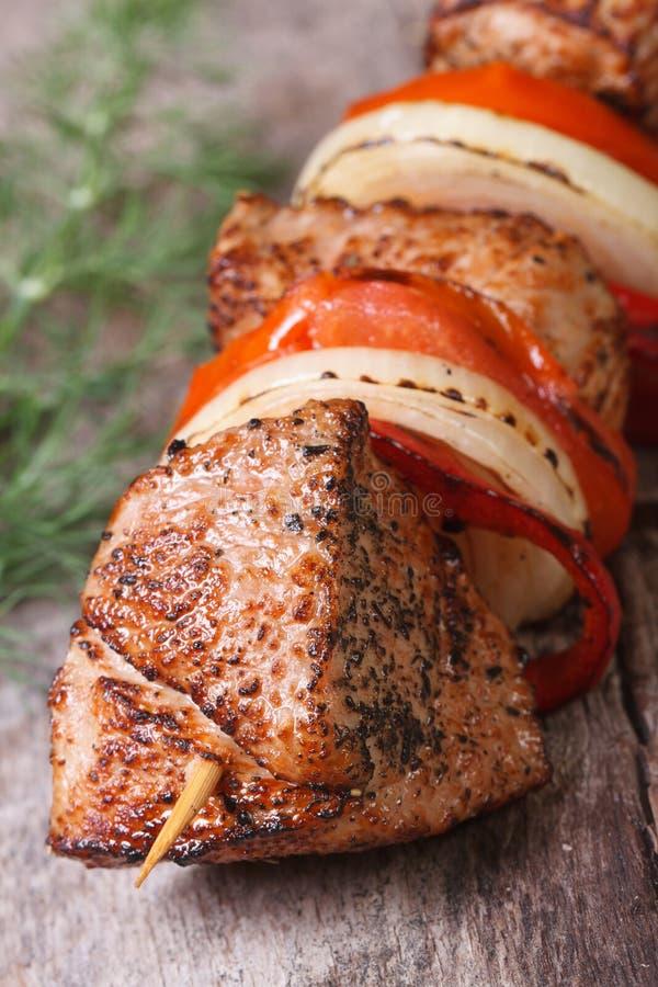 Tasty grilled skewers with vegetables vertical. Macro royalty free stock image