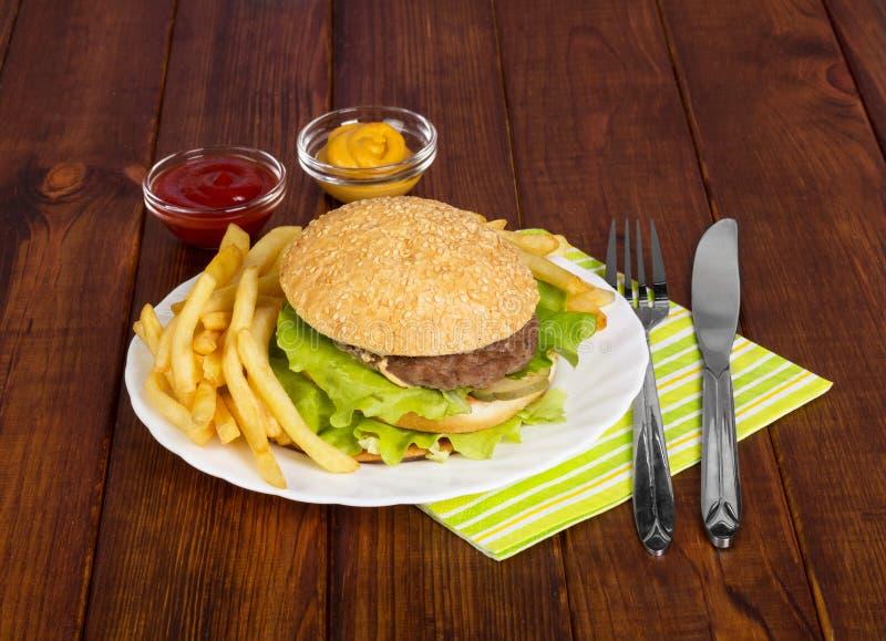 Tasty hamburger on plate stock photos