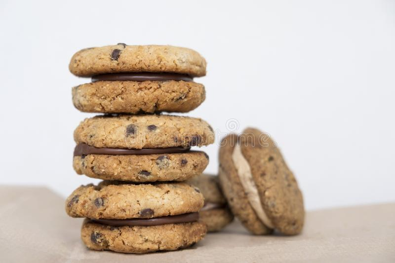 Stack of delicious hazelnut or almond sandwich biscuits with chocolate, ganache and gianduja filling. Baci di dama Ladys kisses. Tasty hazelnut and almond stock image