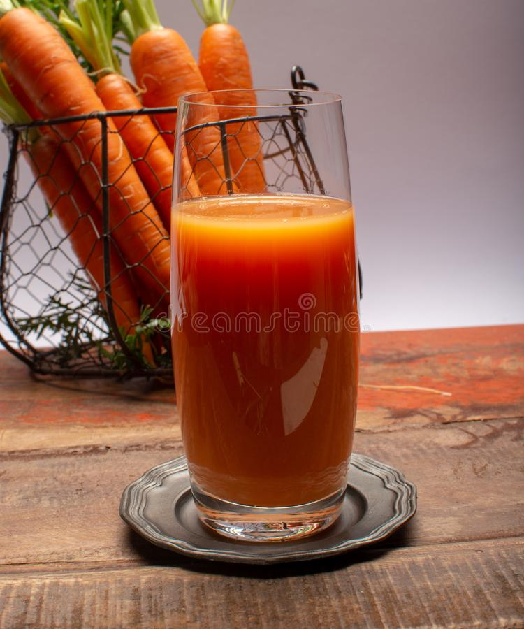 Tasty healthy natural sweet vegetable drink, fresh organic carrot juice ready to drink in glass royalty free stock images